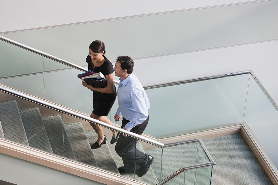 Business people walking up a flight of stairs