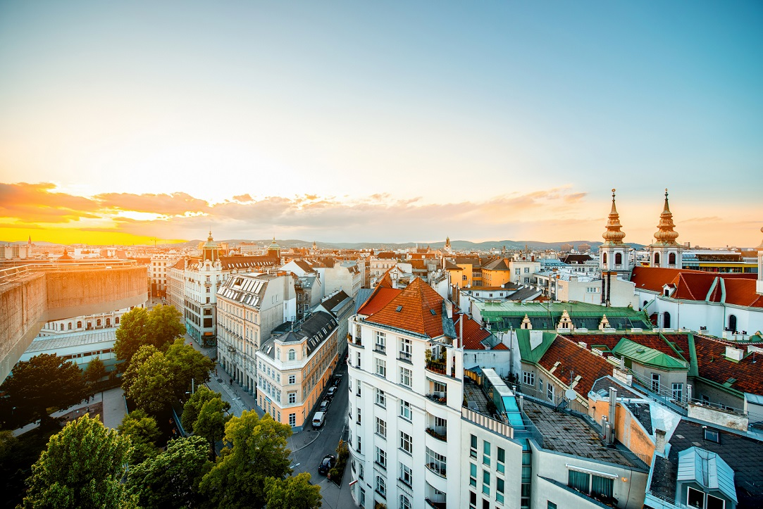 Panoramic cityscape view on Vienna city with Mariahilfer church towers on the sunset in Austria