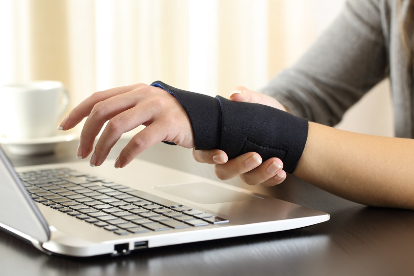 Woman hands with injured wrist complaining