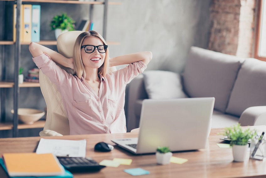 Stylish, pretty, charming, nice economist resting on chair with close eyes at desk in work place, having hands behind the head, dreaming, thinking about holidays, imagine vacation