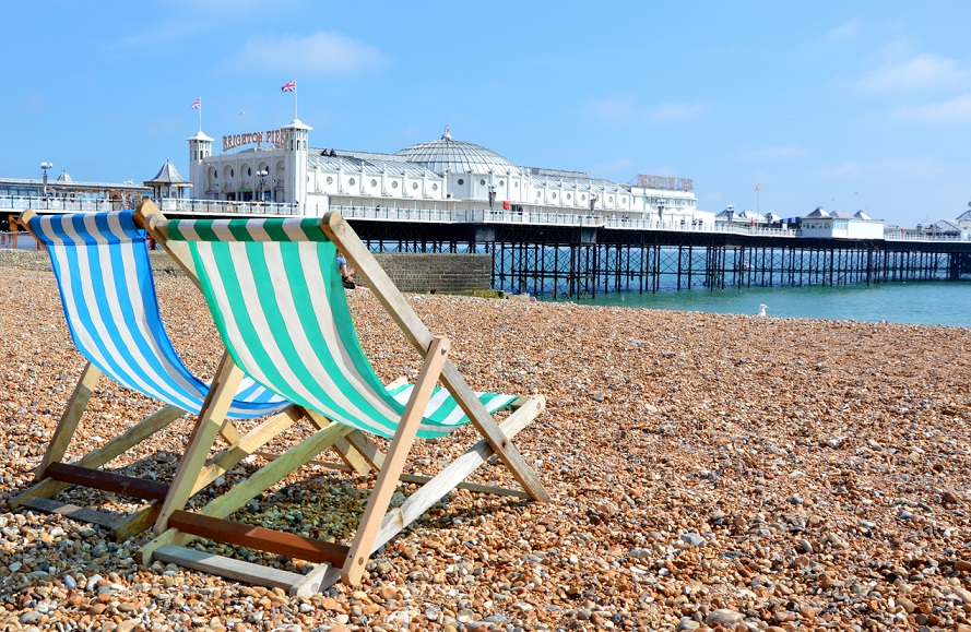 Sun lounger with Brighton Pier in background
