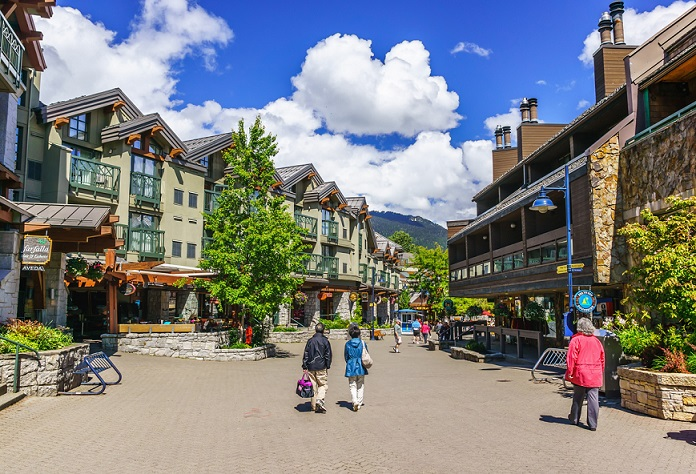 Whistler, British Columbia, Canada - June 10, 2013: Tourists ramble on the street of Whistler, co-host of the 2010 Olympic Games at June10, 2013. It is a Canadian resort town approximately 125 kilometres north of Vancouver.